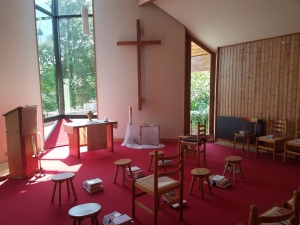 A small chapel with chairs and stools
