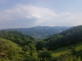 photo overlooking a valley in the mountains