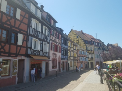rows of colorful, half-timbered houses on a pedestrian street
