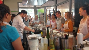 Photo of students receiving instruction in a cooking class