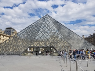 Photo of a glass pyramid, the Louvre museum