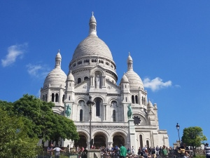 photo of Sacre Couer with a blue sky in the background