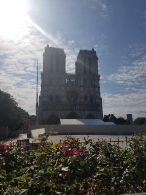 photo of Notre Dame cathedral with a lens flare