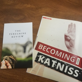 "photo of a book titled ""The Peregrine Review"" and an article titled ""Becoming Like Katniss"""