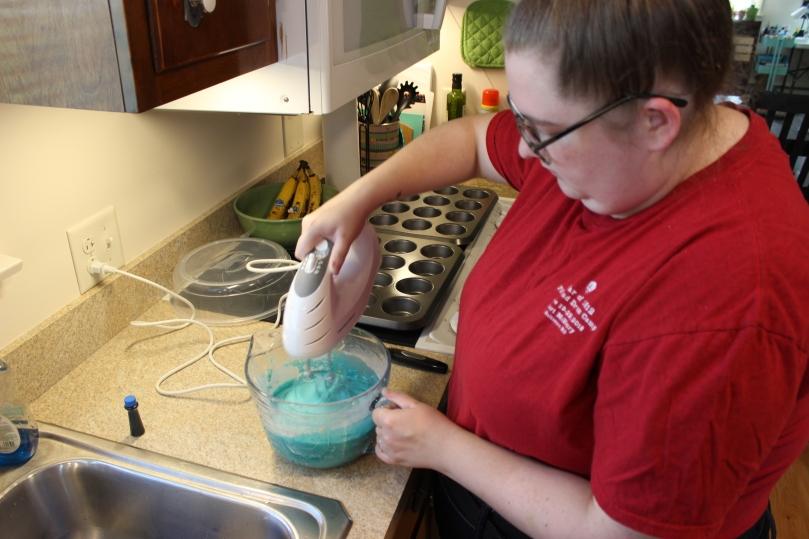 Woman mixing blue cake batter