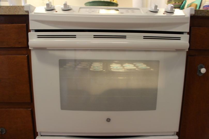 cupcakes baking in an oven